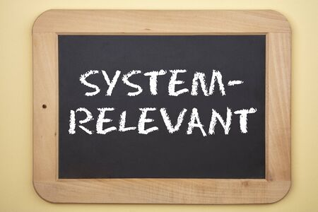 Concept: Systemrelevant in german language means Systemically Significant on blackboard Stock fotó