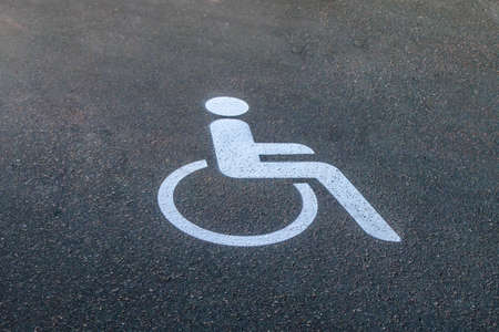 White Road marking for wheelchair users on asphalt