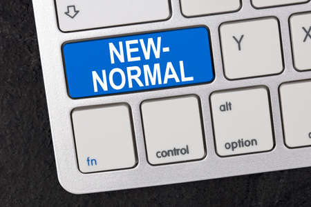 Concept: Word New Normal on av Keyboard