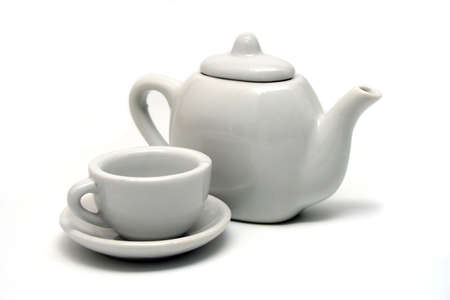 White Tepot and Teacup on White Background Stock Photo