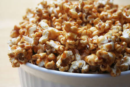 bowl of popcorn: Close up of Caramel Popcorn in a White Bowl