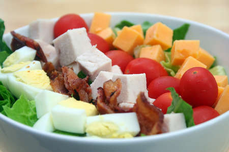 Close Up of Cobb Salad in a White Bowl Stock Photo