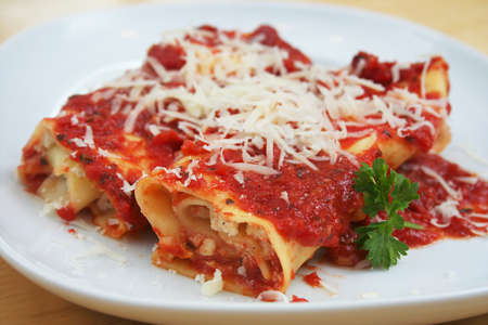 Two Manicotti on a White Plate