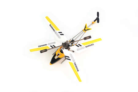 Top View of Yellow Remote Control Helicopter on White Background Stock Photo