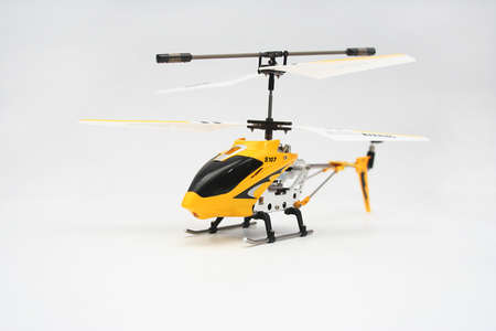 Yellow Remote Control Helicopter on White Background