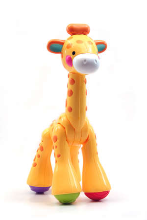 Yellow Plastic Toy Giraffe on a White Background
