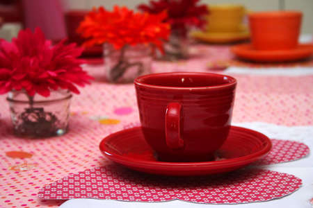 Close up of Red Tea Cup at a Little Girl Stock Photo