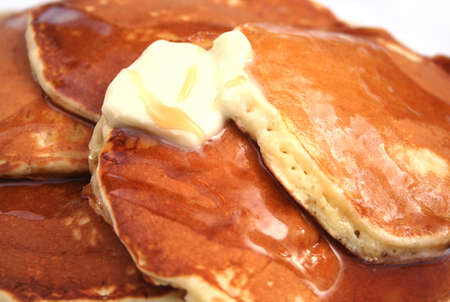 Close Up of Pancakes With Butter and Syrup