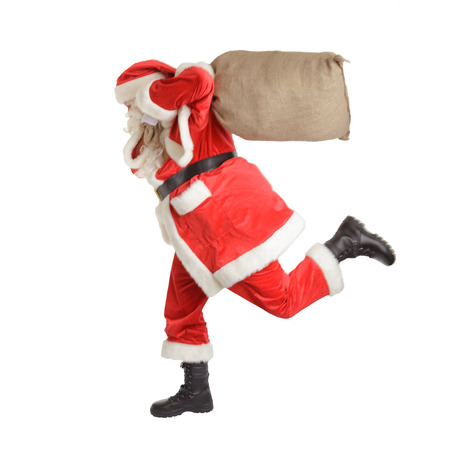 Hurried Santa Claus is running fast. Isolated on white background. Stock Photo