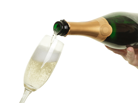 Pouring in sparkling champagne into a glass