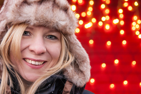 Attractive woman smiling and standing at a christmas market