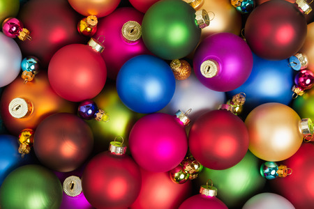 A heap of colorful christmas baubles lying on the floor. Zdjęcie Seryjne