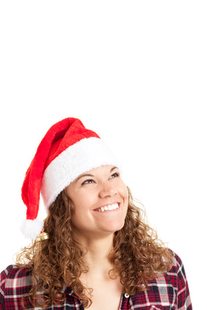 Woman in Santa hat posing isolated on white background. Mixed race caucasian girl happy looking at camera.