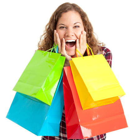 Young woman with her colorful bags is happy about shopping discounts. Black friday concept. Zdjęcie Seryjne
