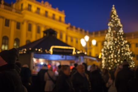 Christmas market in the Advent season in Vienna Schönbrunn Palace. Blurred background.