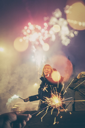 Woman celebrating at New Years Eve outdoors.