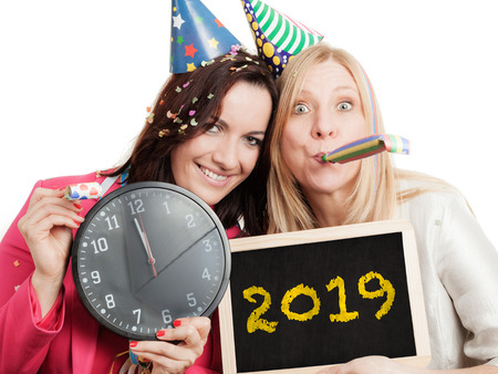 Two women ready to celebrate new year 2019 Zdjęcie Seryjne - 118987446