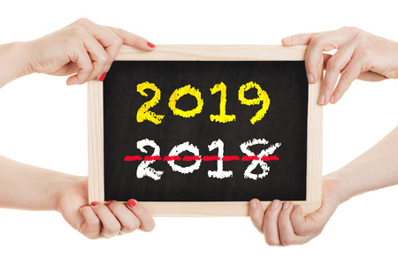 Hands holding chalkboard for the new year 2019 - isolated on white background Zdjęcie Seryjne