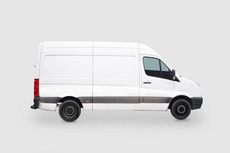 Driving white van isolated on grey background Zdjęcie Seryjne