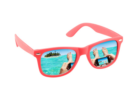 Red sunglasses isolated on a white background. Concept for vacation and holidays.