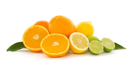 A heap of different tropical citrus fruits isolated on white background. Healthy food and nutrition, vegan lifestyle and organic fair trade concept. Zdjęcie Seryjne