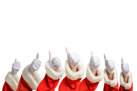 Multiple Santas showing thumbs up isolated on white background.