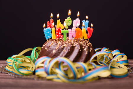 Colorful birthday party cake with candles. Birthday, party and family concept.