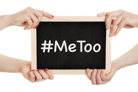 Women holding chalkboard with metoo sign in their hands.