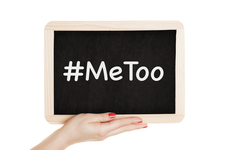 Woman holding chalkboard with metoo sign in her hands.