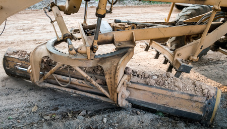 adjust: Motor grader working on road construction adjust level soil improvment