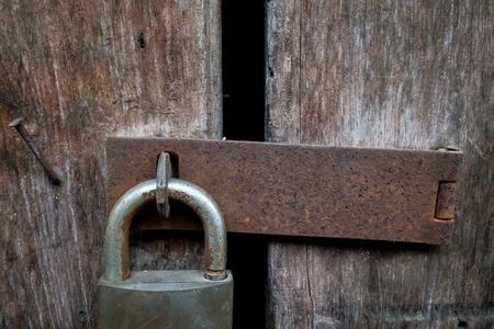 lock and key: Wood texture and  door with master key lock Stock Photo