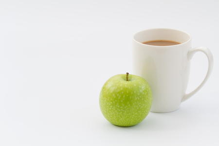 snack time: Coffee break snack time of a healthy fresh apple and a hot cup of coffee.