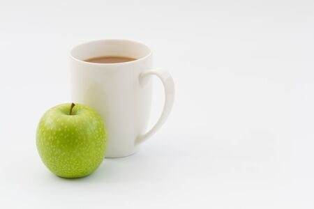 quick snack: A healthy snack of a fresh apple and hot cup of coffee for a quick and simple work break.