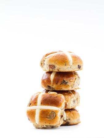 A stack of Easter hot cross buns on an isolated white background.