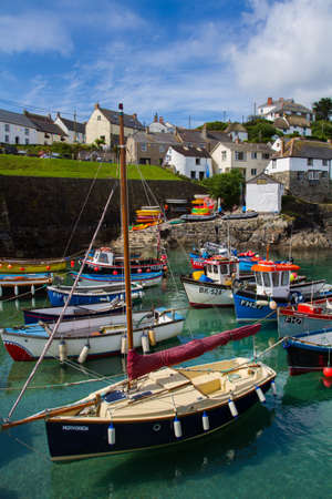 pleasure craft: COVERACK, CORNWALL, UK - CIRCA JULY, 2015. Coverack in Cornwall is an example of a typical Cornish fishing village with fishing boats and pleasure craft moored in the small harbour. Editorial
