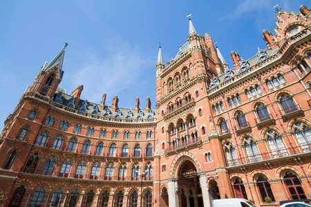 elaborate: KINGS CROSS, LONDON, UK - MAY 5, 2016. The facade and main entrance of The St Pancras Renaissance Hotel in London showing elaborate architectural detail.