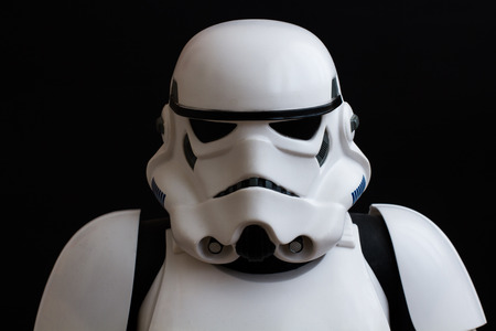stormtrooper: YORK, UK - JUNE 1, 2016. A close up portrait of a Star Wars Stormtrooper from The Force Awakens movie on a black background.