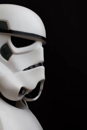 stormtrooper: YORK, UK - JUNE 1, 2016. A close up profile shot of a Star Wars Stormtrooper from The Force Awakens movie on a black background Editorial