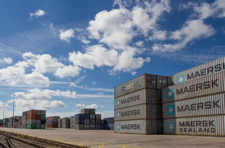exported: DONCASTER, YORKSHIRE, UK - JULY 30, 2016. Cargo and shipping containers stacked up at Doncaster Rail Port before being loaded onto freight trains to be exported from UK docks. Editorial