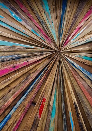 diminishing perspective: An abstract art background created from strips of worn driftwood and arranged in a diminishing perspective pattern to an off centre focal point. Stock Photo