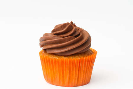 swirled: A chocolate and orange cupcake with swirled frosting or icing on an isolated white background.