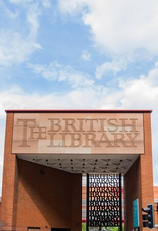 brick sign: LONDON, UK - JULY 21, 2016. The red brick sign above the main entrance to The British Library in London which is the worlds largest library per number of catalogued items.