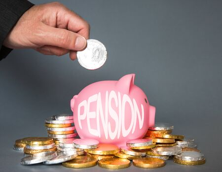 A pension or retirement concept of an employee, employer or person adding and contributing money to a pension scheme with copy space