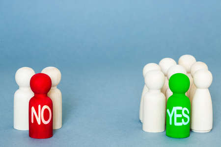 A voting concept with groups of voters and people deciding to vote yes or no in an election, referendum or ballot with a yes majority