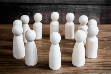 A business or social concept of generic figures grouped into a circle during a meeting, conference or forum discussing various topics. Reklamní fotografie