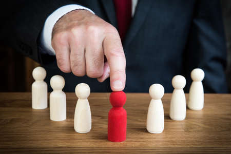 A businessman choosing a team member for promotion to a leadership or management career position or headhunting an employee Stock fotó