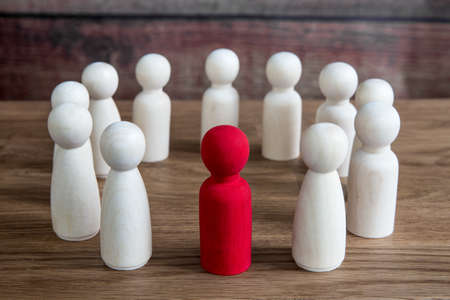 A business or social concept of generic figures grouped into a circle during a meeting, conference or forum discussing various topics with a leader or manager standing out Reklamní fotografie