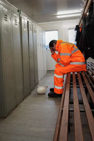 A male employee in the construction or railway industry suffering mental health or grief issues at work