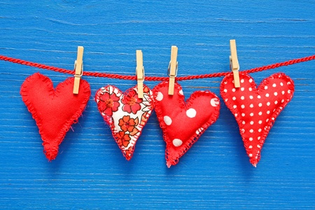Four handmade hearts on a red string