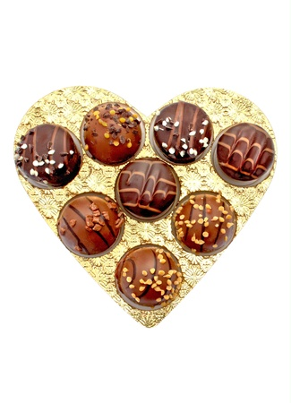 Chocolate candies in heart shaped box